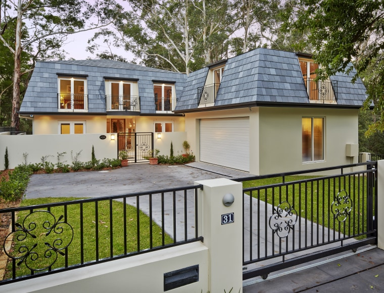Tucked beneath a towering gum tree canopy, this cottage, estate, facade, home, house, property, real estate, residential area, gray