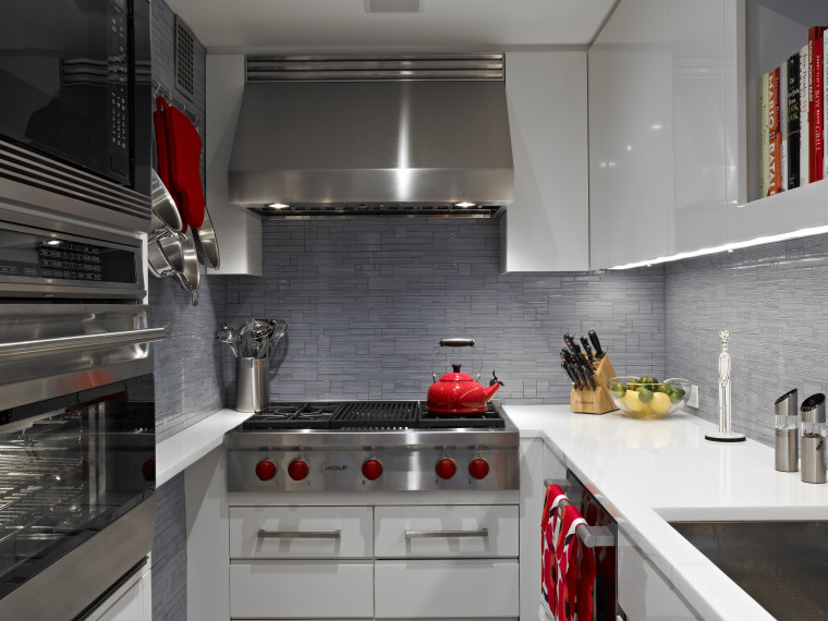 A few red accessories really pop in contrast countertop, interior design, kitchen, room, gray, black