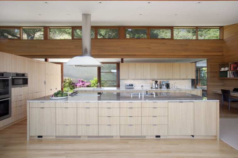 Under-counter storage on this island reduces the need cabinetry, countertop, cuisine classique, hardwood, interior design, kitchen, room, gray