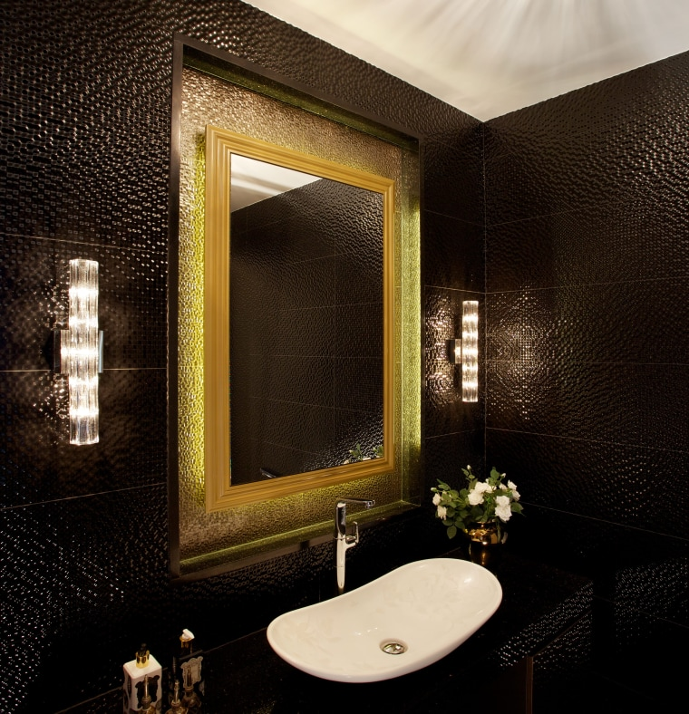 A traditional gilt mirror creates a feature element architecture, bathroom, bathroom accessory, bathroom sink, ceiling, interior design, lighting, mirror, plumbing fixture, property, restroom, room, sink, tile, toilet, wall, wallpaper, black