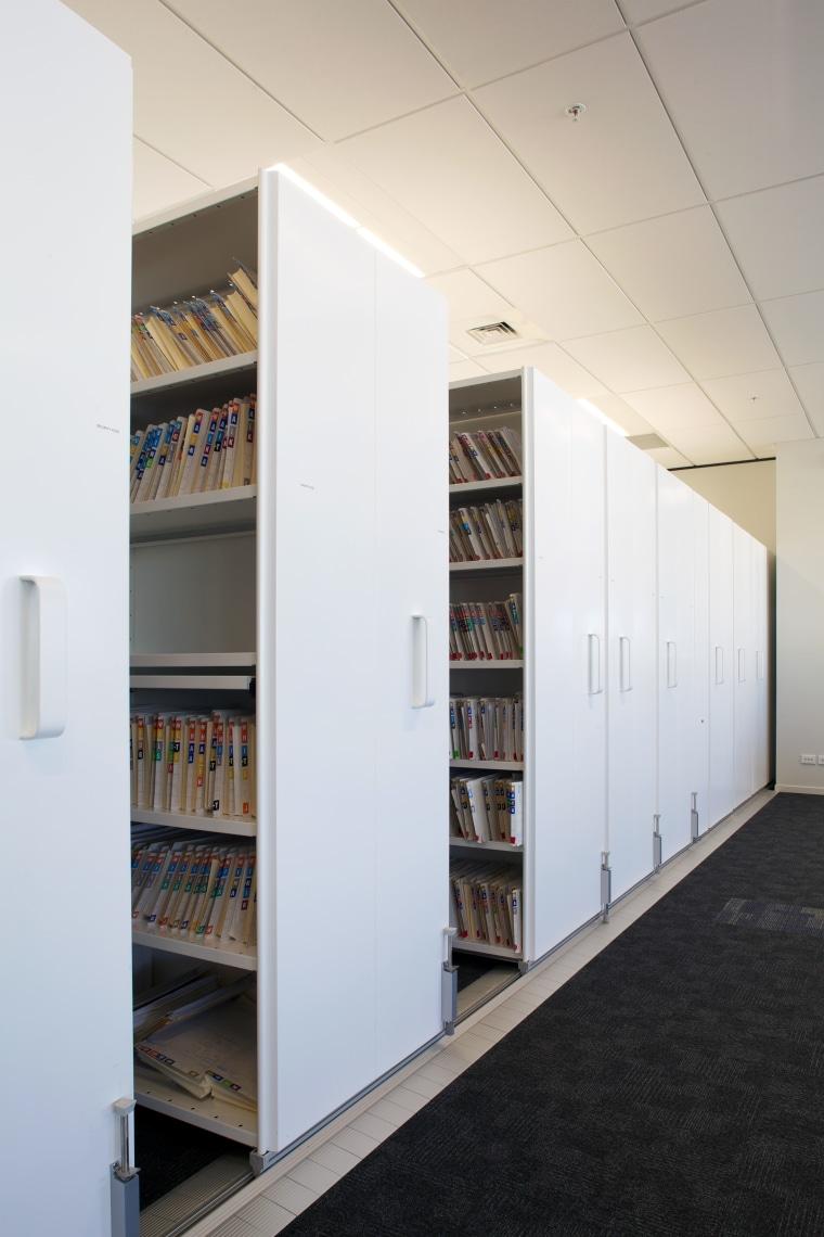 Dexlon Compactus Freetrack 2 mobile shelving system allows architecture, bookcase, furniture, institution, interior design, shelf, shelving, white