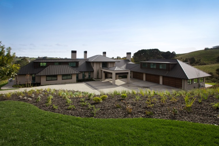 Large modern country home with gabled roof architecture, cottage, estate, facade, farm, farmhouse, home, house, land lot, landscape, property, real estate, residential area, roof, sky, villa, brown