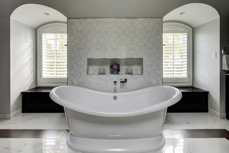 A traditionally styled bathtub enhances the sense of bathroom, bathroom accessory, bathtub, floor, interior design, plumbing fixture, product design, room, sink, tap, gray