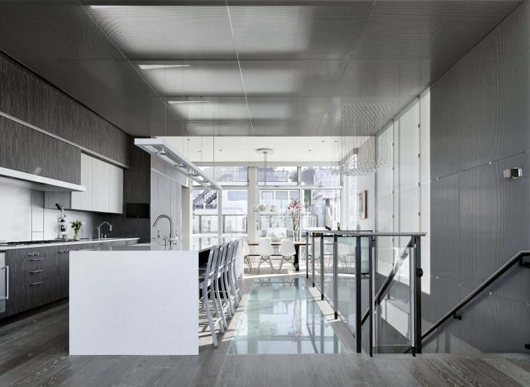 The entire living area is on the top architecture, ceiling, daylighting, floor, interior design, kitchen, loft, real estate, white, gray, black