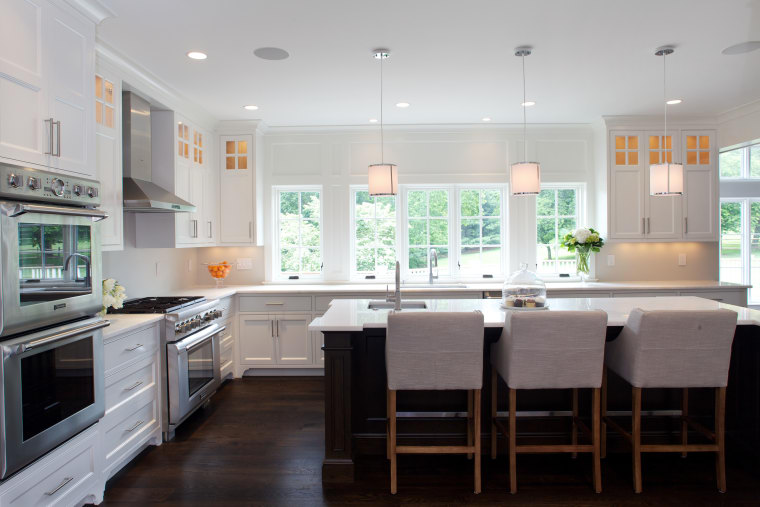 This traditional kitchen offers a wealth of storage, cabinetry, countertop, cuisine classique, interior design, kitchen, real estate, room, window, gray