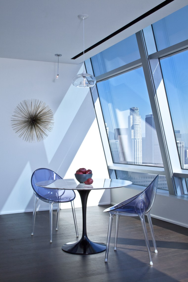 Kartell Philippe Starck chairs are teamed with a architecture, chair, daylighting, furniture, glass, house, interior design, product design, table, window, teal, gray