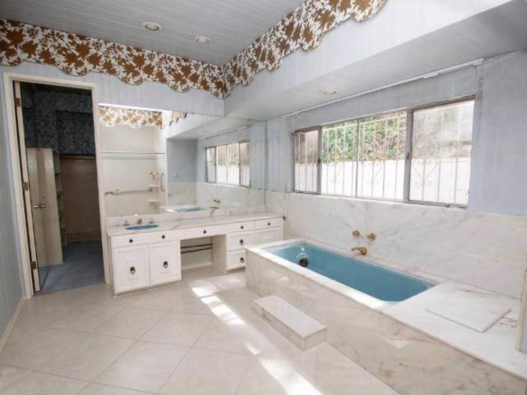 Prior to renovation, the original bathroom was tired bathroom, estate, floor, flooring, interior design, property, real estate, room, tile, gray