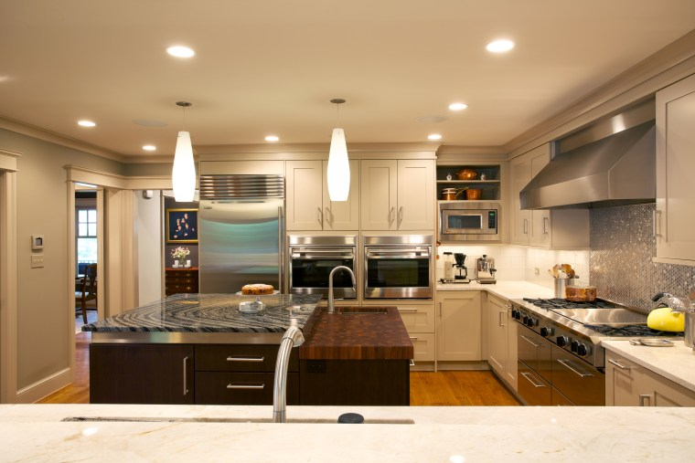 While a mix of materials is appropriate to cabinetry, ceiling, countertop, cuisine classique, interior design, kitchen, room, orange, brown