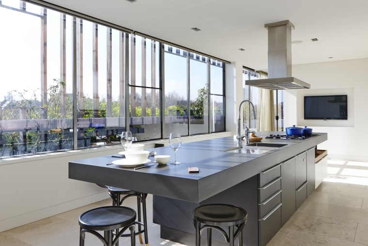The other end of the island has space countertop, interior design, kitchen, real estate, gray