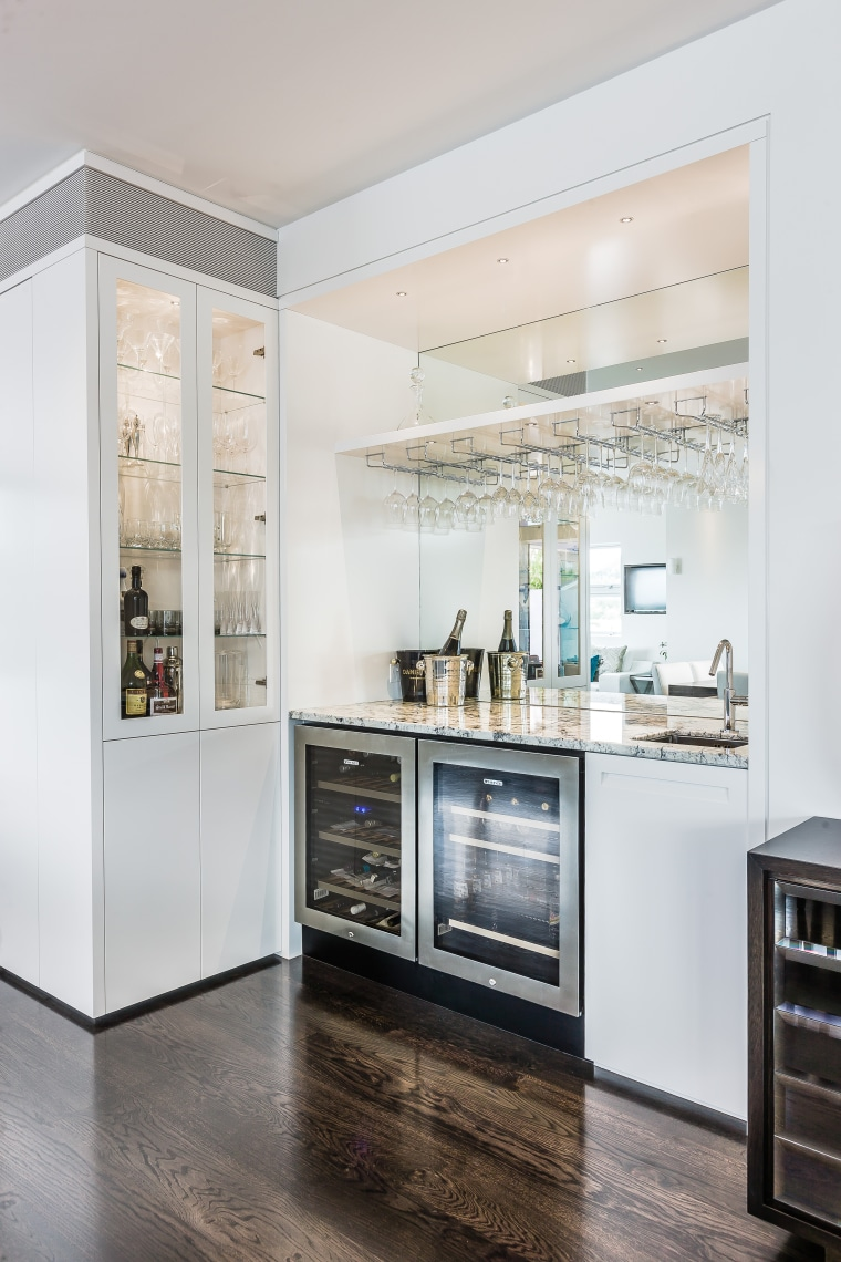 Glass display cabinets with interior lighting enliven the countertop, home appliance, interior design, kitchen, major appliance, refrigerator, white