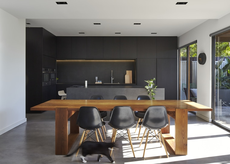 Although the cabinets in this kitchen appear black, countertop, furniture, interior design, kitchen, table, black, gray, white