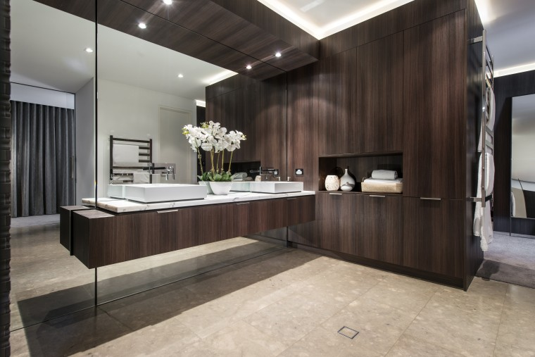 With the mirror wall above and below, this cabinetry, countertop, floor, flooring, interior design, kitchen, room, black, gray
