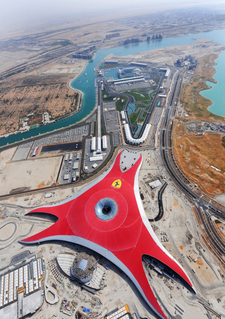 The Ferrari Theme Park features Euramax colour-coated aluminium aerial photography, bird's eye view, city, fixed link, sky, urban area, water, gray