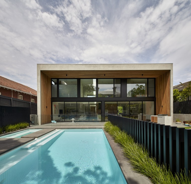 The entire rear facade of this contemporary home architecture, estate, facade, home, house, property, real estate, reflection, roof, sky, swimming pool, villa, gray