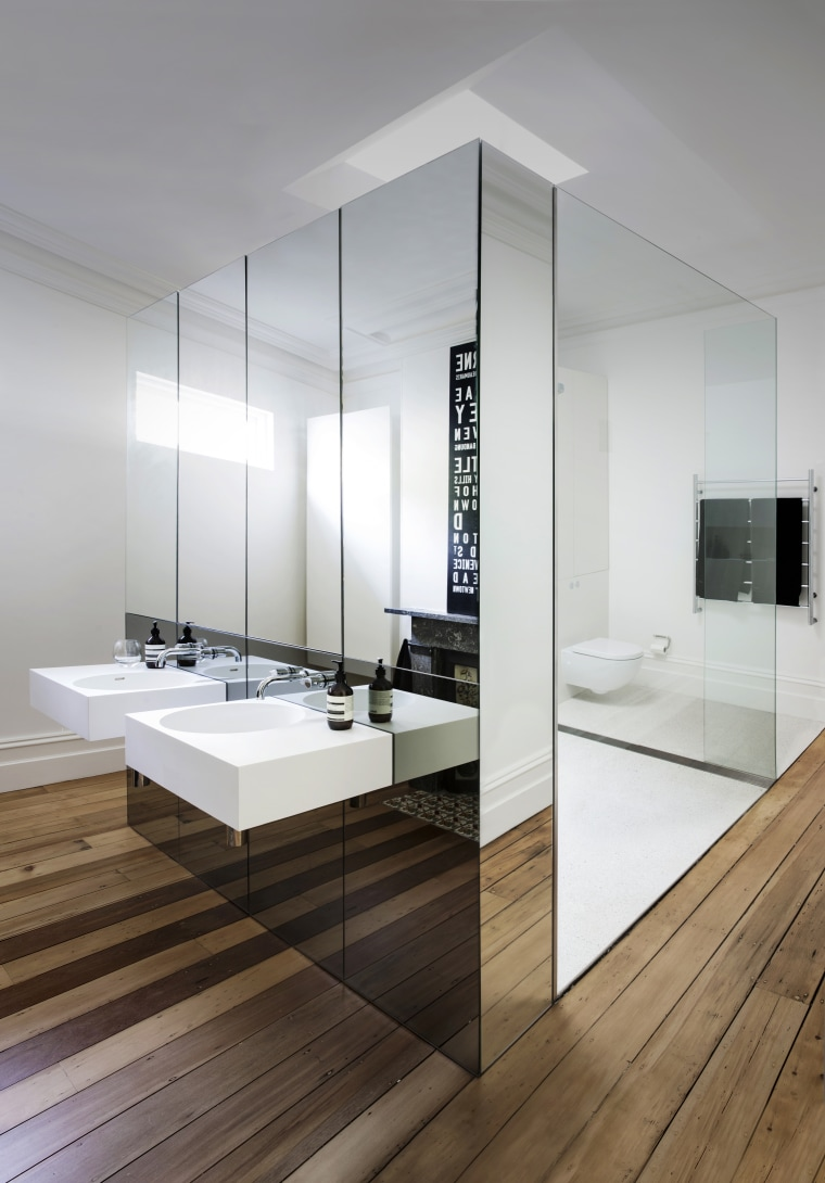 This bathroom utilises mirrors in tandem with bathroom, floor, interior design, sink, white, gray