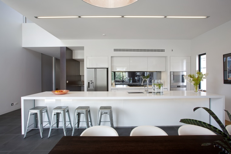 A 5m-long island with a Caesarstone top and architecture, countertop, house, interior design, kitchen, real estate, table, gray