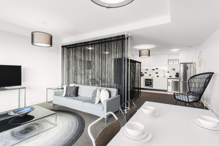 The Block 7 apartments in Auckland have interiors ceiling, interior design, living room, property, real estate, room, white