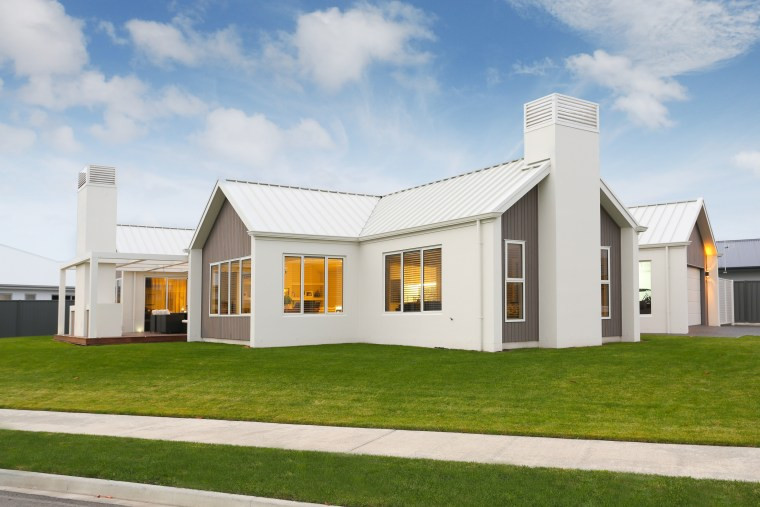 Contemporary pavilion-style home with gabled roofline and white-on-white architecture, cottage, elevation, estate, facade, farmhouse, home, house, property, real estate, residential area, white, brown