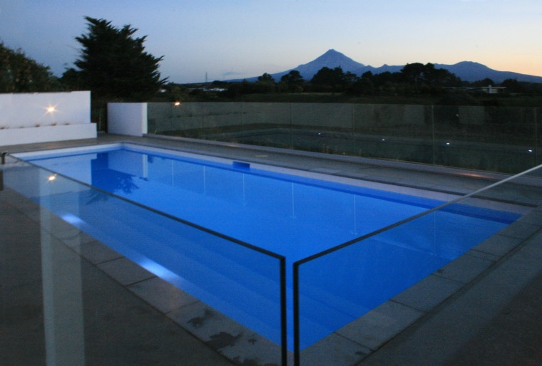 This fibreglass pool by Mayfair Pools features an daylighting, glass, leisure, lighting, property, roof, structure, swimming pool, water, black, blue