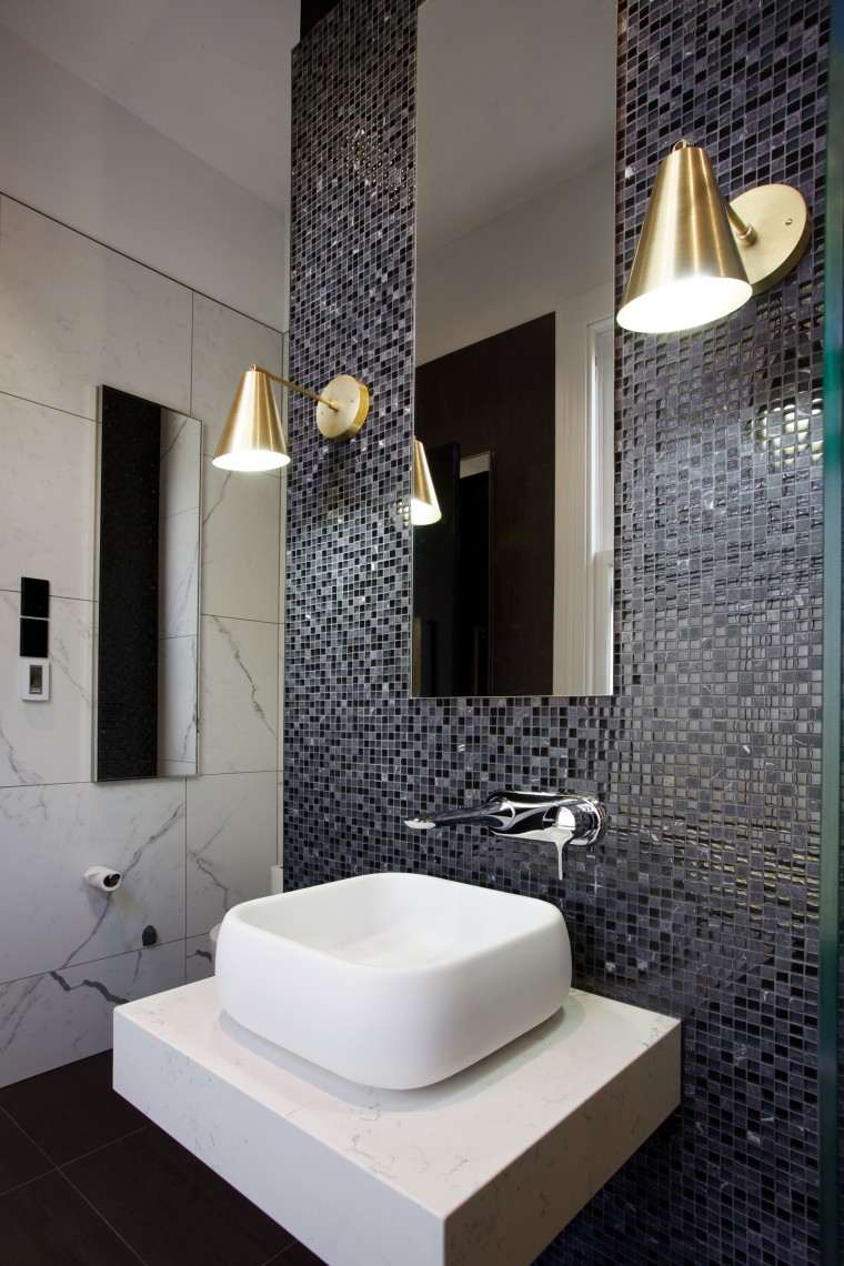 Mosaic tiles wrap around chimney breast that had architecture, bathroom, ceramic, floor, flooring, interior design, plumbing fixture, product design, room, sink, tile, wall, gray, black