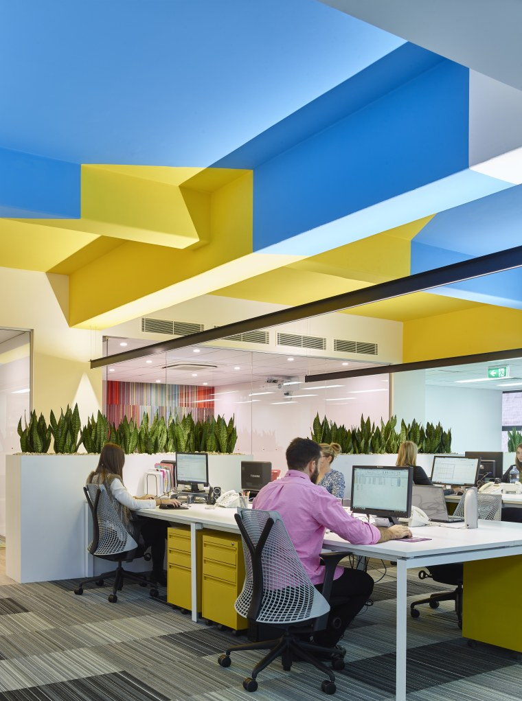 The ceiling pattern in this renovated office intersects architecture, ceiling, interior design, office, real estate, yellow