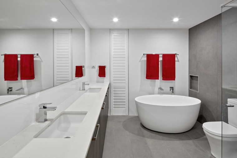A clean white material palette sets off the architecture, bathroom, floor, interior design, plumbing fixture, product design, room, sink, tap, gray