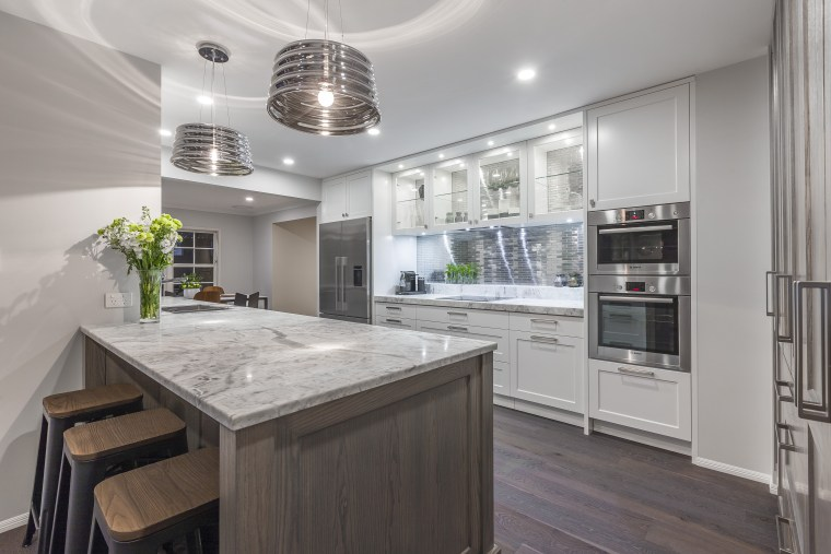 This eclectic, finely balanced aesthetic is by designer cabinetry, countertop, cuisine classique, interior design, kitchen, real estate, gray
