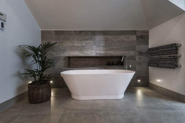 Stone look tile surfaces showcase the bathing space architecture, bathroom, floor, flooring, interior design, product design, room, tile, wall, gray