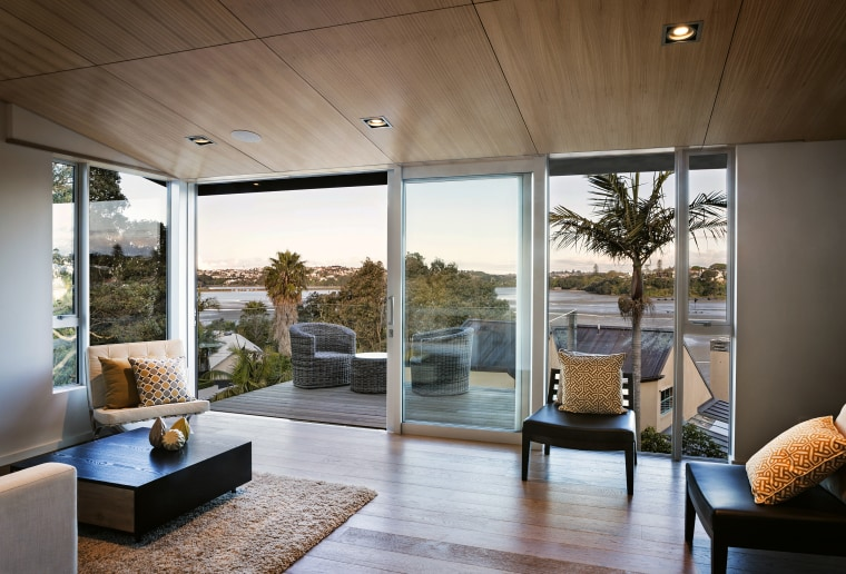 Eastern views are enjoyed from the formal living architecture, home, house, interior design, living room, real estate, window, brown
