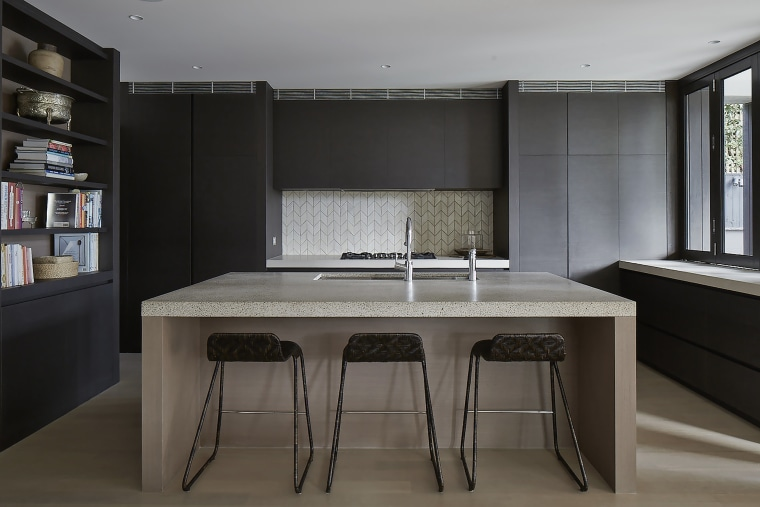 The minimalist kitchen in this new living  countertop, furniture, interior design, kitchen, table, black, gray