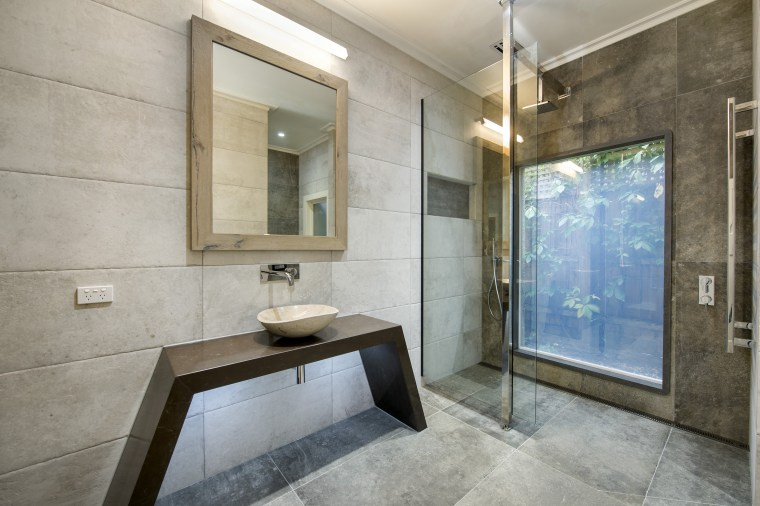 High-tech switch glass turns a shower wall into bathroom, estate, floor, interior design, property, real estate, room, gray