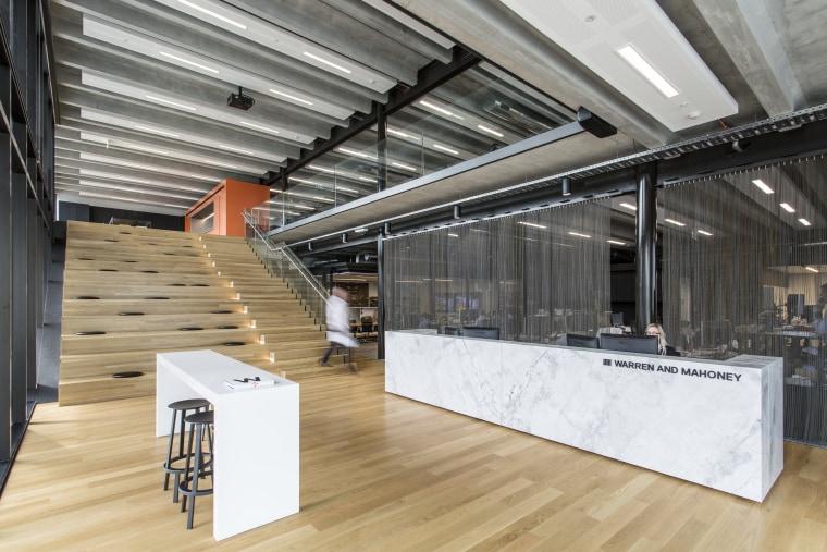 Warren and Mahoneys own studio features a stairway architecture, interior design, gray