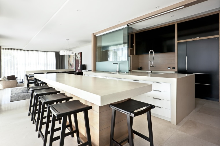 This kitchen by designer Leon House features suspended countertop, interior design, kitchen, real estate, white