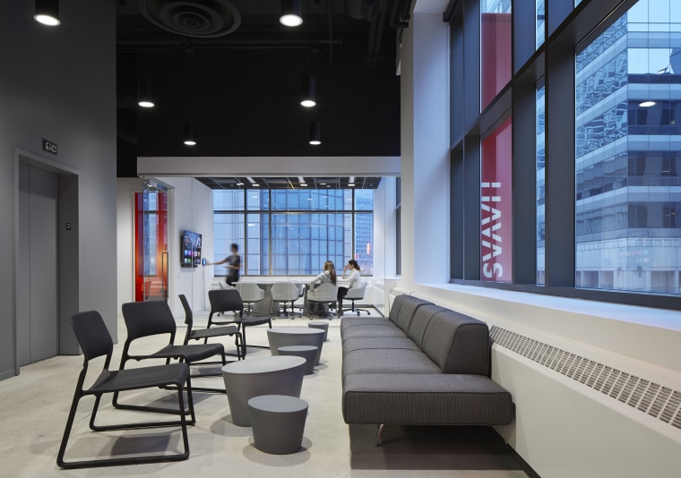 The reinvented, down-sized offices of Havas in Chicago furniture, interior design, living room, lobby, black, gray