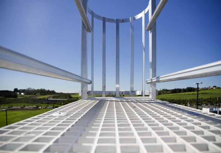 Monkey Toe safety systems provide worker safety and architecture, bridge, building, cable stayed bridge, corporate headquarters, daytime, energy, extradosed bridge, fixed link, landmark, sky, structure, teal, gray