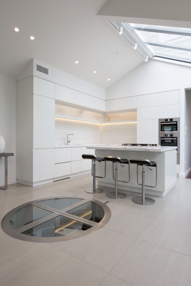 A circle of glass in the floor is architecture, ceiling, countertop, daylighting, floor, interior design, kitchen, product design, table, gray