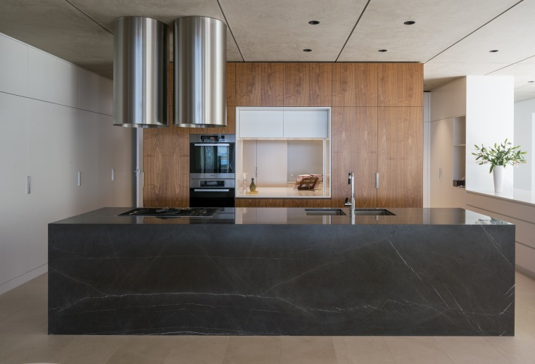 A benchtop pocket slider can screen off the architecture, ceiling, countertop, floor, flooring, interior design, kitchen, laminate flooring, lobby, real estate, wood flooring, gray, black