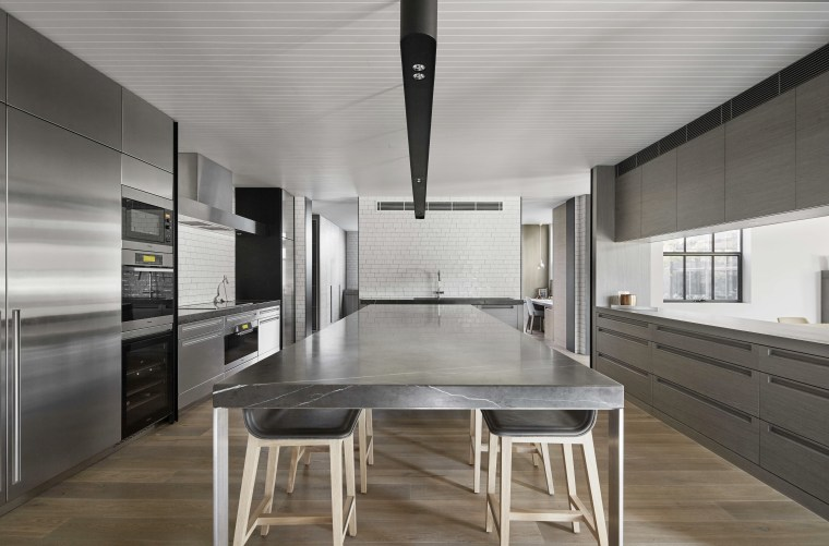 The elongated island in this kitchen by BE architecture, countertop, floor, interior design, kitchen, gray