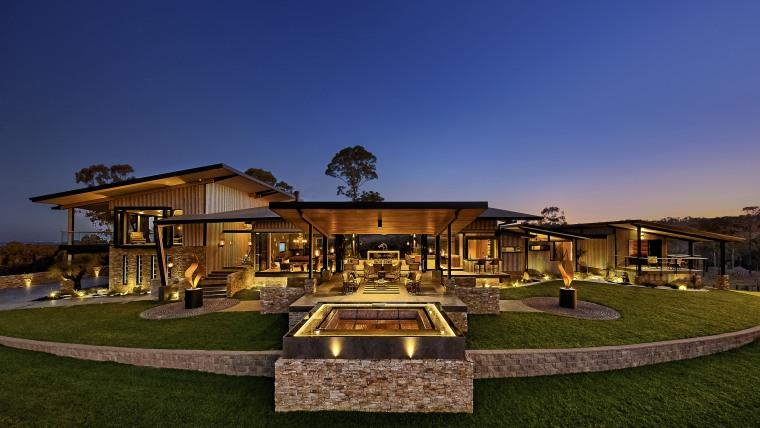 The sunset lounge and fire pit stretch out backyard, cottage, estate, hacienda, home, house, landscape, lighting, mansion, property, real estate, residential area, resort, sky, villa, blue, brown
