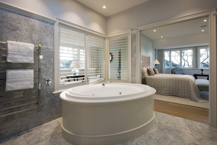 Open sesame  a push of a pocket bathroom, bathtub, estate, floor, home, interior design, real estate, room, window, gray