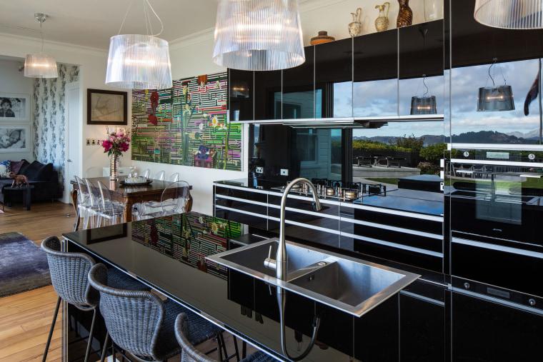 Designer Damian Hannah chose a bevel-edged Smeg sink countertop, interior design, kitchen, black, gray
