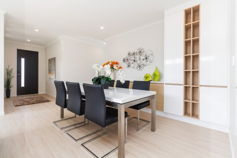 A custom vertical wine rack is one of floor, flooring, interior design, property, real estate, room, table, white