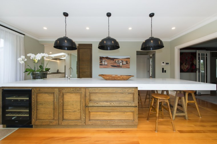 Crafted meets contemporary with this entertainers kitchen island, cabinetry, countertop, cuisine classique, furniture, hardwood, interior design, kitchen, room, table, gray