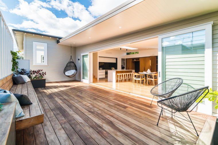 A large deck and outdoor bench virtually double deck, estate, floor, flooring, hardwood, home, house, interior design, laminate flooring, outdoor structure, property, real estate, siding, window, wood, wood flooring, white