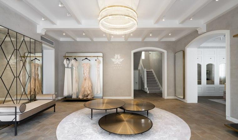 This reinvented villa retains classic features such as ceiling, estate, floor, flooring, interior design, living room, lobby, gray