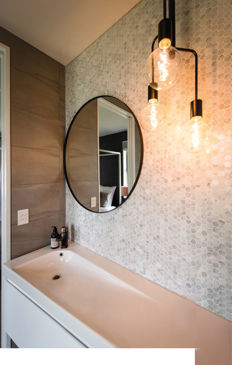 Designer lighting and a feature wall set off bathroom, home, interior design, lighting, room, sink, wall, brown, white
