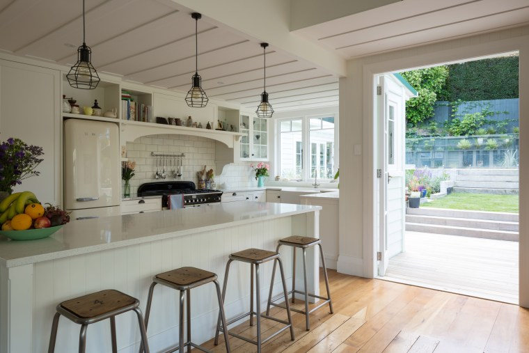 Classic elements like panel doors, brass pulls, subway countertop, estate, floor, home, house, interior design, kitchen, property, real estate, room, window, gray