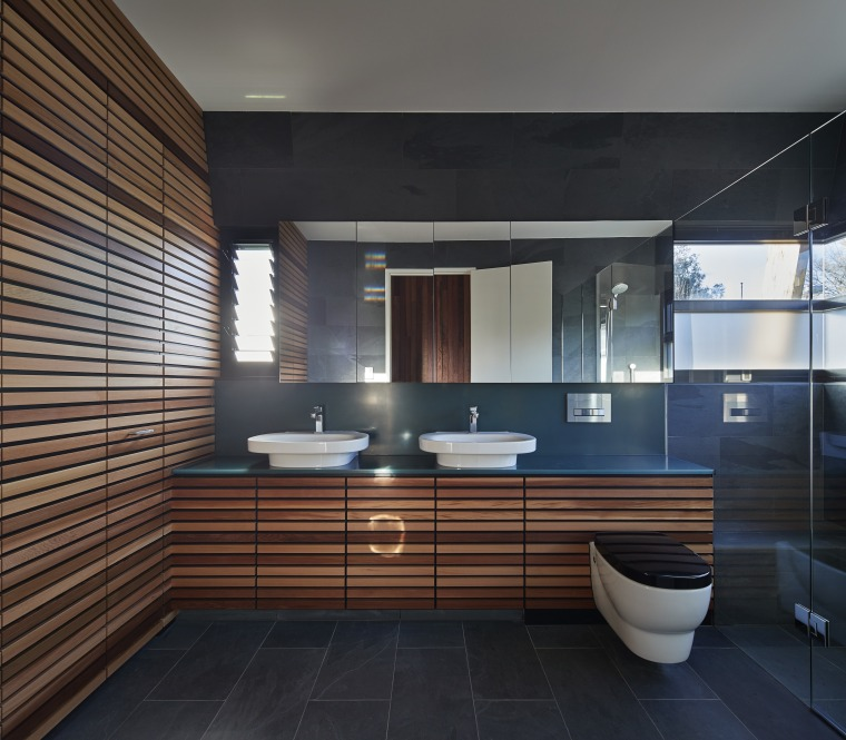 This is one of two identical bathrooms in architecture, bathroom, interior design, room, black, gray