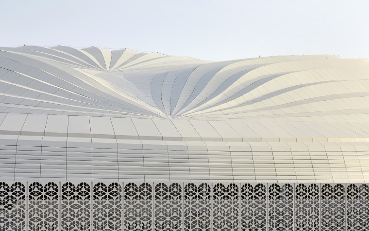 The stadium's roof design is an abstraction of architecture, line, textile, white