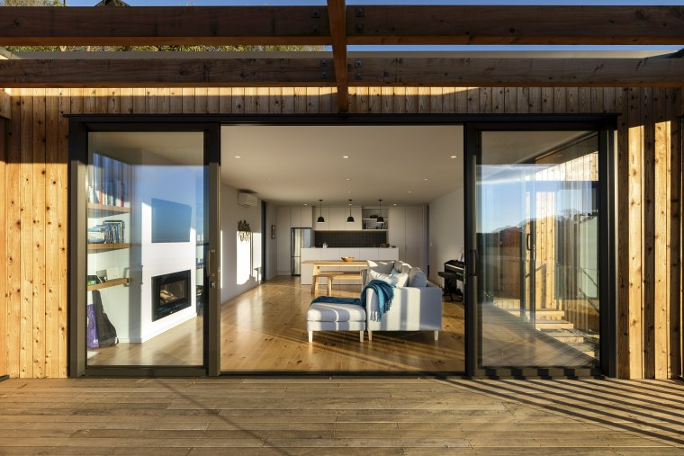 Spatially, the living wing aligns with the north, door, house, interior design, real estate, window, brown
